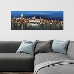 Canvas 16 x 48 - City by night with reflection on water