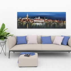 Canvas 20 x 60 - City by night with reflection on water