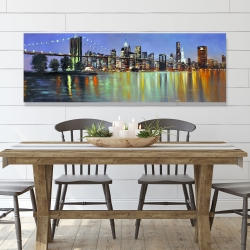 Canvas 20 x 60 - Colorful city with a bridge by night