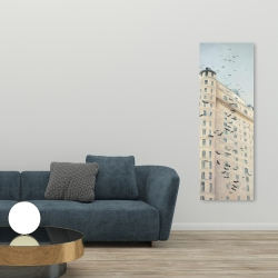 Canvas 20 x 60 - Birds flying in front of a building