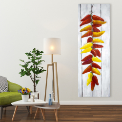Canvas 20 x 60 - Rope of peppers with wood background