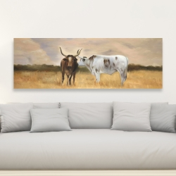 Canvas 20 x 60 - Two cows kissing by sunset