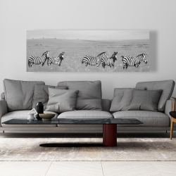 Canvas 20 x 60 - Zebras in the savannah