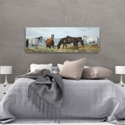 Canvas 20 x 60 - Horses eating in the meadow