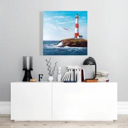 Toile 24 x 24 - Phare au bord de la mer