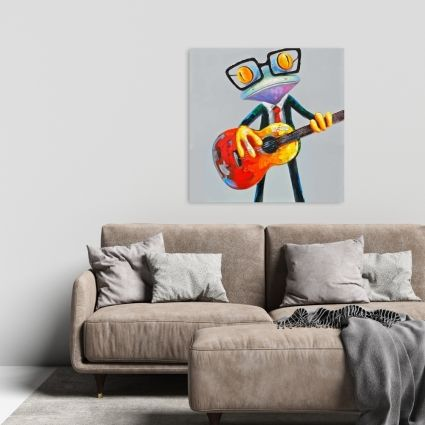 Funny frog playing guitar