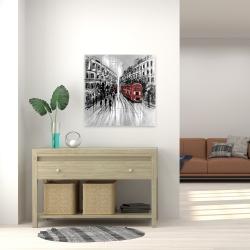 Toile 24 x 24 - Rue en noir et blanc avec bus rouge