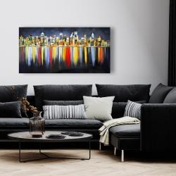 Toile 24 x 48 - Réflexion colorée d'un paysage urbain de nuit