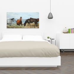 Canvas 24 x 48 - Horses eating in the meadow