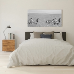 Canvas 24 x 48 - Zebras in the savannah