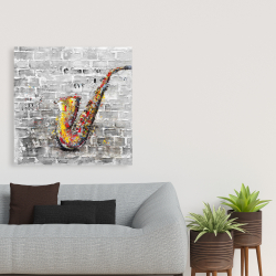 Canvas 36 x 36 - Graffiti of a saxophone on brick wall