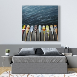 Canvas 48 x 48 - Colorful paddles on the dock