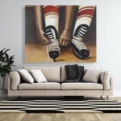Canvas 48 x 60 - Hockey player ties his skates