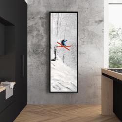 Framed 20 x 60 - Man skiing in steep offpiste terrain
