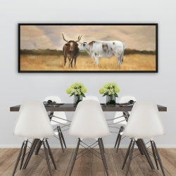 Framed 20 x 60 - Two cows kissing by sunset