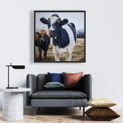Framed 24 x 24 - Two cows eating grass