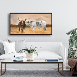 Framed 24 x 48 - Two cows kissing by sunset