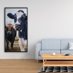 Framed 24 x 48 - Two cows eating grass