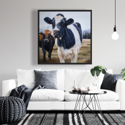 Framed 36 x 36 - Two cows eating grass