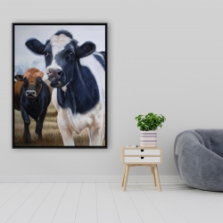 Framed 36 x 48 - Two cows eating grass