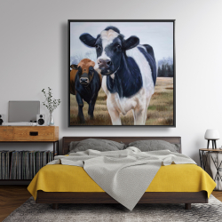 Framed 48 x 48 - Two cows eating grass