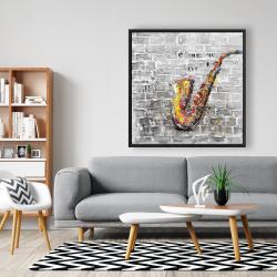 Framed 48 x 48 - Graffiti of a saxophone on brick wall