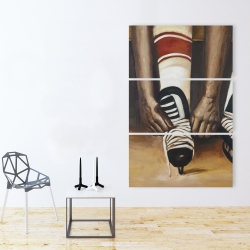 Canvas 40 x 60 - Hockey player ties his skates