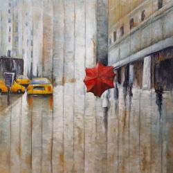 Red umbrella in the street
