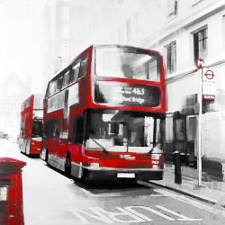 Red bus in a gray street