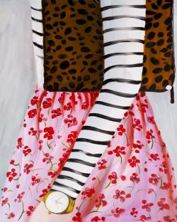 Fashionable woman with a leopard bag