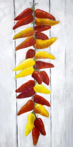 Rope of peppers with wood background