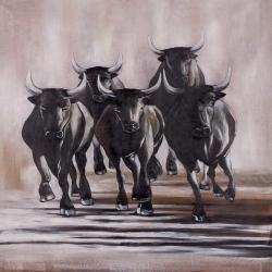 Group of running bulls