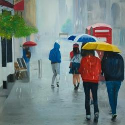 People walking under umbrella by a rainy day