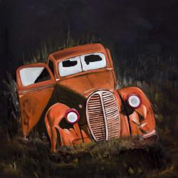 Humpy old car by night