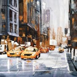 Big city street with yellow taxi