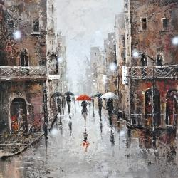 Woman with a red umbrella in a snowy street