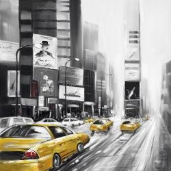 Traffic of yellow cars in a gray city