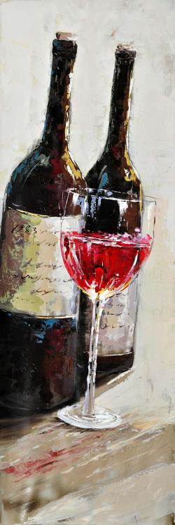 Two bottles with a glass of wine