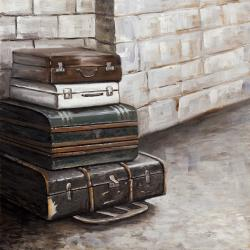 Four old traveling suitcases