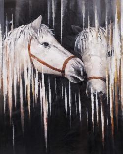 Two white horses kissing