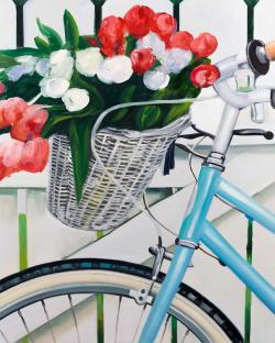 Bicycle with tulips flowers in basket