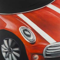 Red car with white stripes closeup