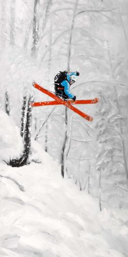 Man skiing in steep offpiste terrain