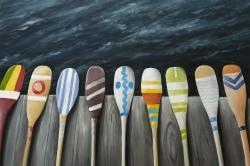 Colorful paddles on the dock