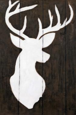 White silhouette of a deer on wood