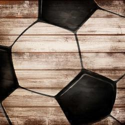 Soccer ball on wood