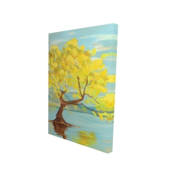 Spring lanscape with a tree in a lake