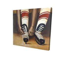 Toile 24 x 24 - 3D - Un joueur de hockey attachant ses patins