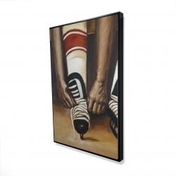 Encadré 24 x 36 - 3D - Un joueur de hockey attachant ses patins