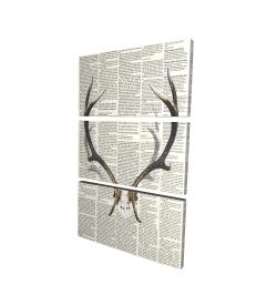 Deer horns with newspaper background